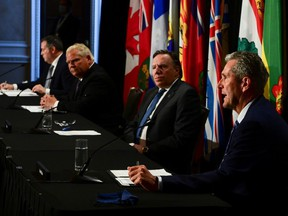 Manitoba Premier Brian Pallister, right, speaks as Quebec Premier Francois Legault, Ontario Premier Doug Ford, and Alberta Premier Jason Kenney look on during a press conference in Ottawa on Friday, Sept. 18, 2020.