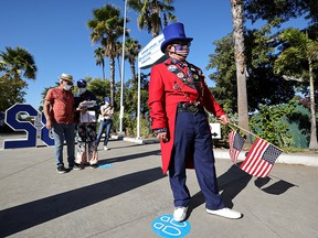 People keep social distance as they wait in line to vote in the U.S. presidential election on the first day of expanded California in-person voting in Los Angeles on Oct. 30, 2020.