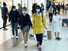 Shoppers at a mall in Toronto in October. The city has all but ended its contract tracing work, unable to keep up with the surge in infections.