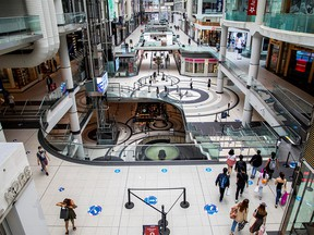 FILE PHOTO: People walk in the Eaton Centre shopping mall in Toronto, Ontario, Canada June 24, 2020.
