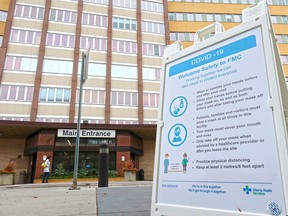 A COVID-19 information sign is seen outside the Foothills Medical Centre in Calgary.