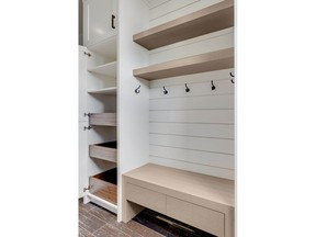 This linen closet, byRockwoodCustom Homes, includes drawers and open shelves to help sort and store items.