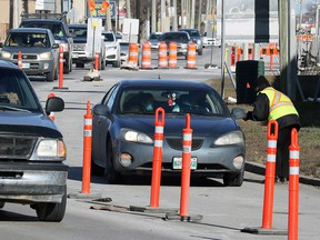 Security helps with directions near the entrance to a COVID-19 drive-thru testing site on King Edward Street in Winnipeg on Sunday, Nov. 1, 2020.