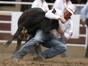 Curtis Cassidy of Donalda, Alta., competes in steer wrestling during the Calgary Stampede on July 15, 2017.