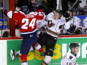 The Calgary Hitmen's Luke Prokop battles the Lethbridge Hurricanes' Dylan Cozens during their first-round WHL playoff series at the Scotiabank Saddledome in Calgary on March 28, 2019.