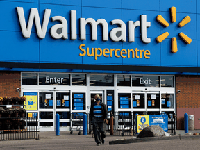 A customer is turned away from an Edmonton Walmart that was temporarily closed after eight employees tested positive for COVID-19 in September.