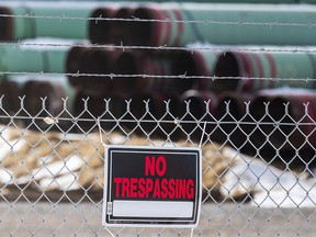 In this Dec. 18, 2020 photo, pipes to be used for the Keystone XL pipeline are stored in a field near Dorchester, Neb.