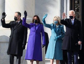 Doug Emhoff, U.S. Vice President-elect Kamala Harris, Jill Biden and President-elect Joe Biden wave as they arrive on the East Front of the U.S. Capitol for the inauguration on January 20, 2021 in Washington, DC. PHOTO BY JOE RAEDLE/GETTY IMAGES