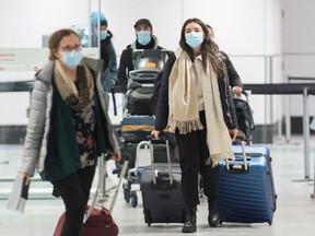 Passengers are shown in the international arrivals hall at Montreal-Trudeau Airport in Montreal, Tuesday, December 29, 2020, as the COVID-19 pandemic continues in Canada and around the world.