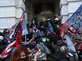 Trump supporters clash with police and security forces as they storm the US Capitol in Washington, DC on Jan. 6, 2021.