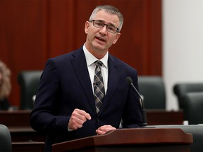 Minister of Finance Travis Toews delivers the 2021 Alberta Provincial budget at the Alberta Legislature, in Edmonton Thursday Feb. 25, 2021.