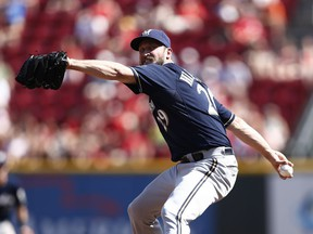 Jim Henderson of the Milwaukee Brewers pitches against the Cincinnati Reds at Great American Ball Park in Cincinnati, Ohio, on Aug. 25, 2013.