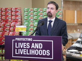 Labour and Immigration Minister Jason Copping announces Alberta's plan to recognize hundreds of thousands of critical workers who continue to support and provide services to Albertans during this pandemic at a news conference from Belmont Sobeys in northeast Edmonton on Feb. 10, 2021.