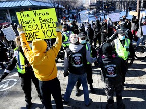 Calgary police were busy keeping peace as hundreds of anti-mask protesters and counter-protesters faced off at City Hall in Calgary on Saturday, February 27, 2021.