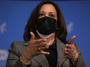 U.S. Vice President Kamala Harris wore two masks when she got her second dose of the Moderna vaccine at the National Institutes of Health in Bethesda, Maryland, U.S. Jan. 26, 2021.