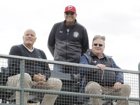 From left, Okotoks Dawgs vice-president William Gardner and managing director John Ircandia, and Western Canadian Baseball League president Kevin Kvame pose for a photo in the new Core 4 Corner seating area at Seaman Stadium in Okotoks on Sept. 2, 2020.