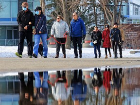A busy afternoon on the Bow River pathway in Calgary on Sunday, Feb. 28, 2021.