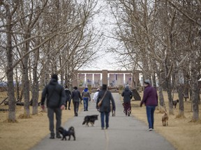 People spend the overcast afternoon in Tom Campbell's Hill Natural Park on Wednesday, March 24, 2021.