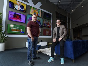 Mike Lowe, left, and Neil Gruninger, Kidoodle.TV founders, pose for a photo at their office in Calgary on Thursday, March 25, 2021.