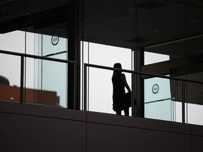 A person walks through a plus-15 walkway near the Chinese Cultural Center in Calgary on Wednesday, March 24, 2021.