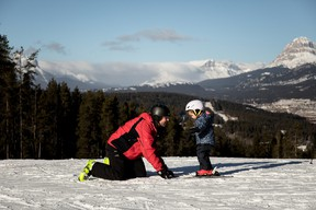 An image of a father and a daughter at Pass Powderkeg Ski Area in Crowsnest Pass, Alberta, Canada.
