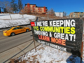 Multi-family buildings in Crescent Heights are seen behind a City of Calgary sign advertising the City's proposed new community guidebook on Tuesday, March 23, 2021.