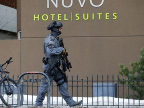 Calgary police investigate an officer-involved shooting at the Nuvo Hotel in Calgary on Wednesday, March 3, 2021.