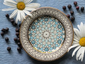Slip-trailed, hand-painted dessert plates by Tanya Everard.