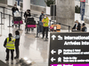 Travellers await transportation to a COVID-19 quarantine hotel after arriving at Toronto's Pearson International Airport, Wednesday February 24, 2021.