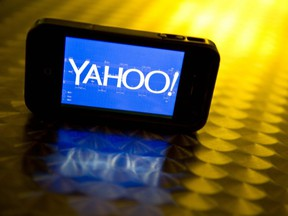 This file photo illustration taken on September 12, 2013 shows the Yahoo logo, seen on a smartphone.