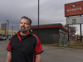 Bennys Breakfast Bar owner Kevin Young poses for a photo outside his restaurant in Calgary on Friday, April 9, 2021.