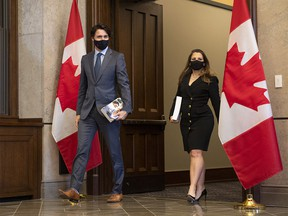 Prime Minister Justin Trudeau, left, arrives with Deputy Prime Minister and Minister of Finance Chrystia Freeland as she prepares to table the federal budget in the House of Commons in Ottawa, on Monday, April 19, 2021.