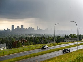 Downtown Calgary is seen from Nose Hill Park moments before it was taken over by stormy clouds on Thursday, July 23, 2020.