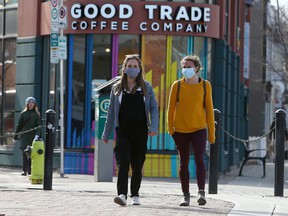 Talia Campbell and Jessica O'Connell are seen wearing their masks while walking Kensington Rd. NW. Thursday, April 8, 2021.