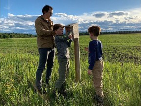 Rob, Ian and Kevin Schorn work as a family to monitor bluebird boxes each spring and summer. Courtesy, Laura Schorn