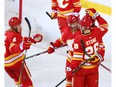 The Calgary Flames celebrate Johnny Gaudreau's goal against the Edmonton Oilers at the Scotiabank Saddledome in Calgary on Saturday, April 10, 2021.