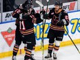 The Calgary Hitmen celebrate during their 7-4 win over the Lethbridge Hurricanes at the Enmax Centre in Lethbridge on Sunday, March 21, 2021.Erica Perreaux/Special to Postmedia