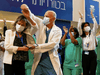 That's the spirit! Healthcare workers in Israel do a celebratory dance before getting their COVID-19 vaccine shots. In Canada, getting the COVID vaccine only gets you a grim admonition to stay the hell home.