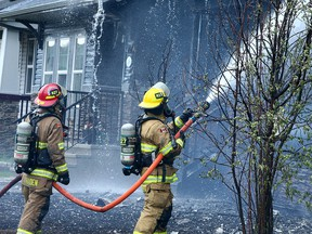 Fire crews battle a fire that damaged multiple homes along Skyview Spring Cres. N.E. Tuesday, May 18, 2021.