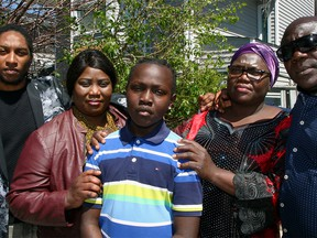From left, Adam Massiah, a member of the Calgary Police Service anti-racism committee, auntie Reia Silvane, mother Joice Wolter and uncle Mathew Dudu stand with 12-year-old Kobe Amadi in front of the family's NE home. Kobe was aggressively tackled to ground by a Calgary police member in April who wrongfully identified him. Sunday, May 30, 2021.