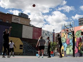 A game of hoops at The Bounce Outdoor Basketball Courts on a warm afternoon downtown. Saturday, May 29, 2021.