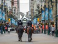 Calgary's mounted police patrol Stephen Avenue on Friday, May 7, 2021.