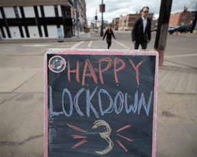 A sidewalk sign reflects some of the frustration of Calgarians amid the latest COVID restrictions. Alberta had the highest percentage of people who responded in a poll that they've lost trust in the federal and provincial governments.