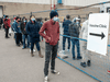 People line up for the COVID-19 vaccination clinic in Toronto on Tuesday May 11, 2021.