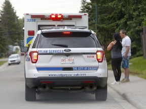 EMS and bylaw at scene of a dog bite at 15th Avenue and 39th Street S.W. after two people were attacked by a pitbull in Calgary on Sunday, June 6, 2021.