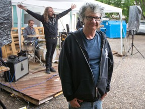 A live jam session plays behind The Blues Can owner Greg Smith at the bar's outdoor stage area on a damp Saturday evening, June 19, 2021.