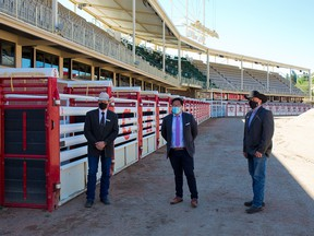 Dana Peers, Interim CEO, Calgary Stampede, Dr. Jia Hu, public health physician, advisor to the Calgary Stampede and Steve McDonough, President & Chairman of the Board, Calgary Stampede were photographed in the rodeo infield area after an update on safety measures for this year's Stampede on Monday, June 14, 2021.