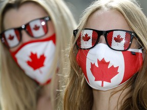Becca Buist, left, and Kendra Hogg are thrilled with the idea that mandatory masks may soon be a thing of the past.