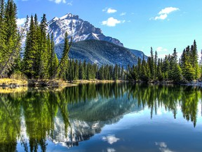 Cascade Mountain reflecting in the Bow River in Banff National Park, Alberta, Canada.