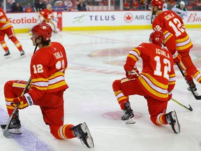 Sean Monahan and current Flames wear Jarome Iginla's No. 12 in warmup after Iginla's jersey retiring ceremony at the Scotiabank Saddledome in this photo from March 2, 2019.